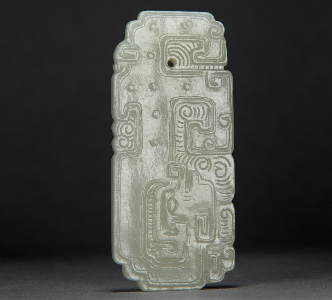 A Carved Hetian White Jade of Auspicious Dragon Pendant