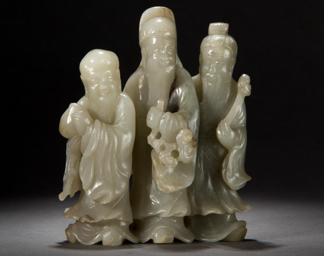 A Carved Hetian White Jade figure of Fortune Gods Qing