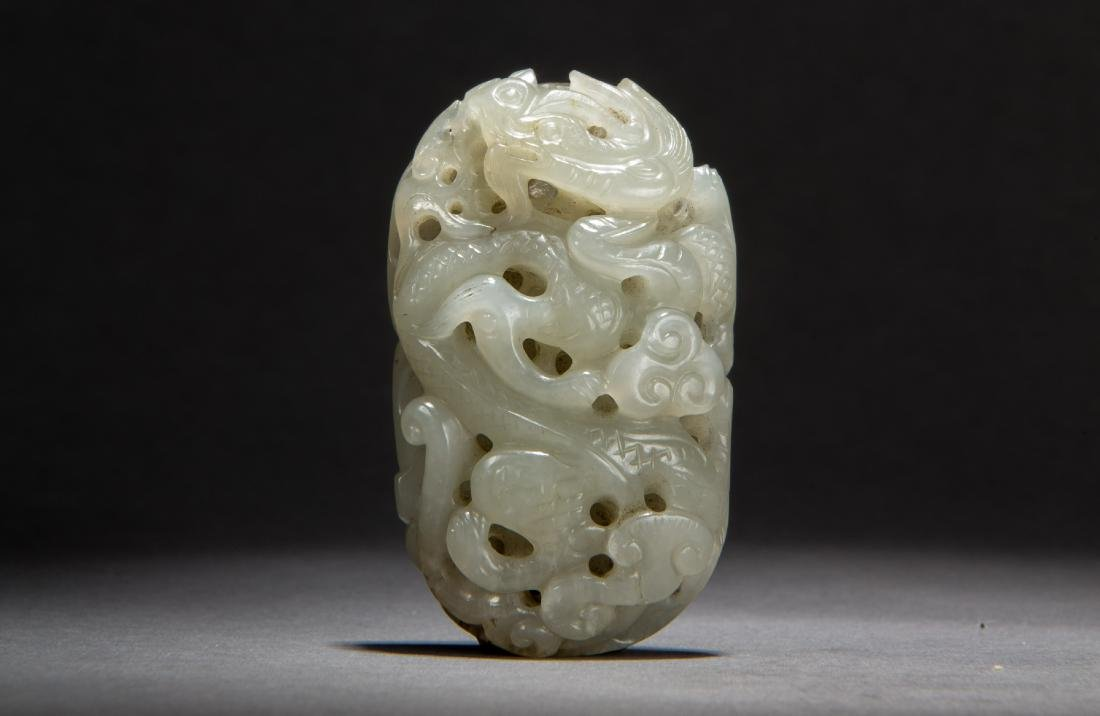 A Hetian White Jade Pendant of Dragon and Phoenix Qing