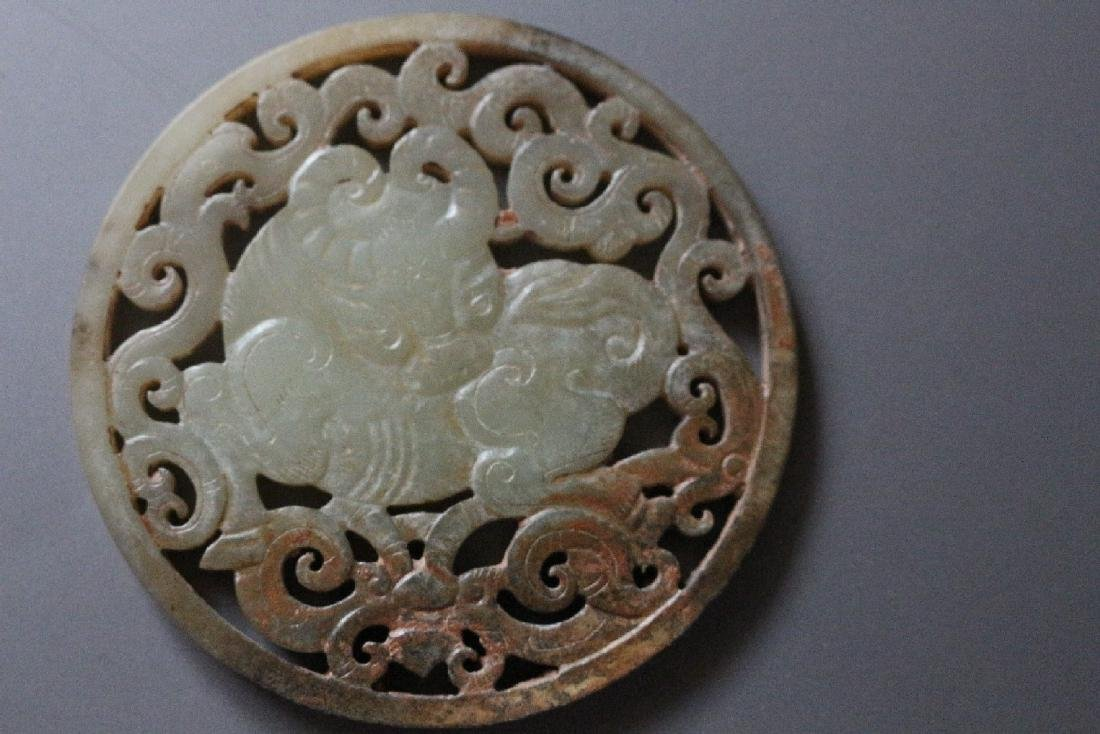 A Carved white Jade Pendant of an Auspicious Ox Qing