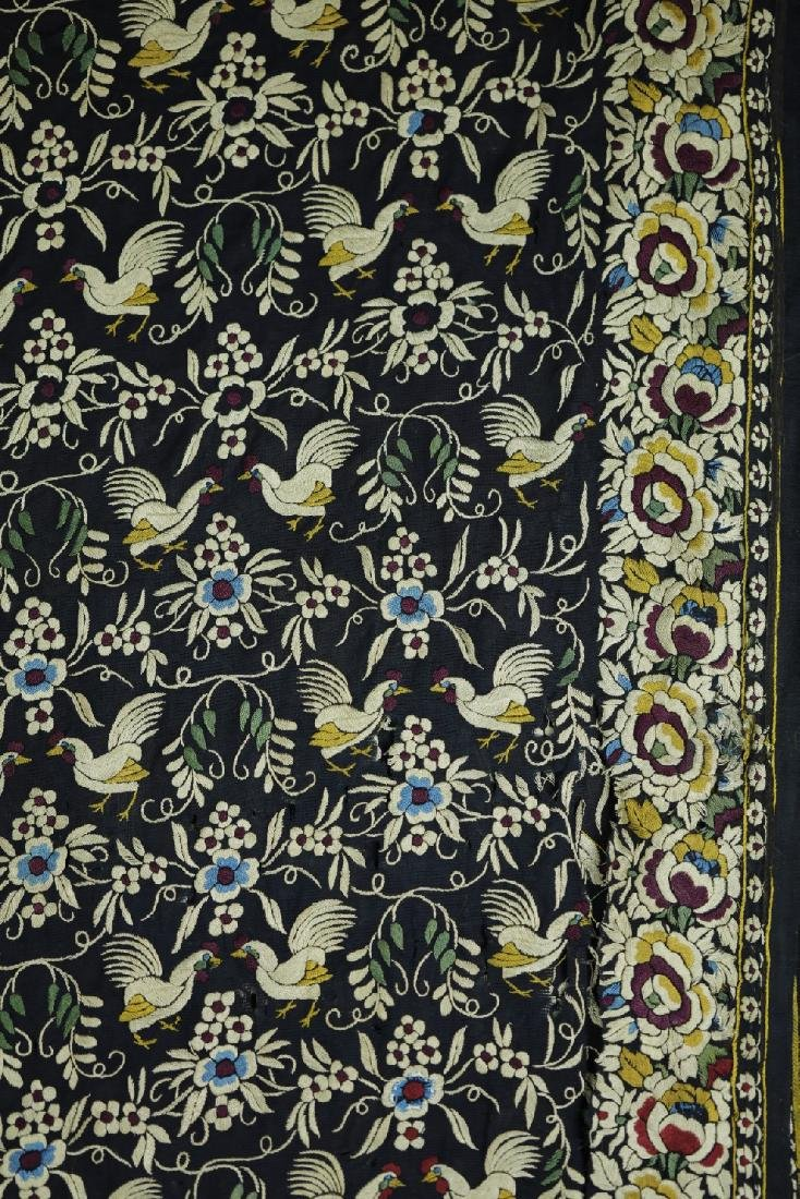 Embroidery of roosters and flowers