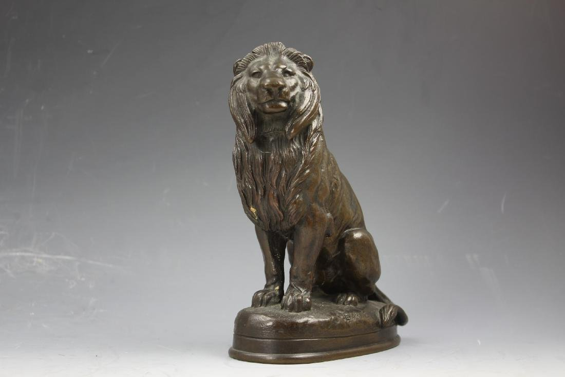 Bronze figure Lion Assis seated lion signed by Barye
