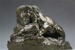 Bronze figure Lion devouring a boar signed by Barye