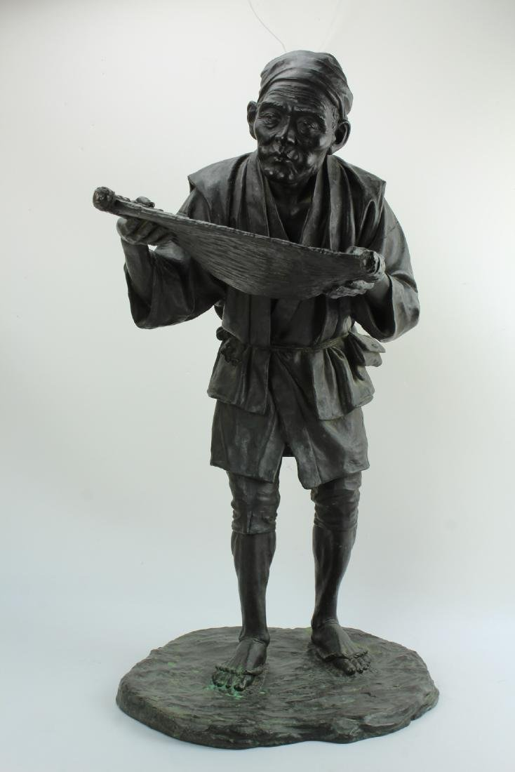 Bronze figure of a Japanese man by Kanejiro Kaneda