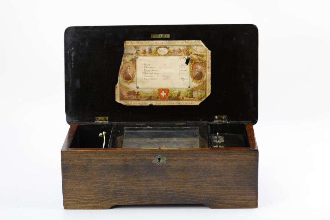 A wonderful vintage mechanical music box with 6 songs