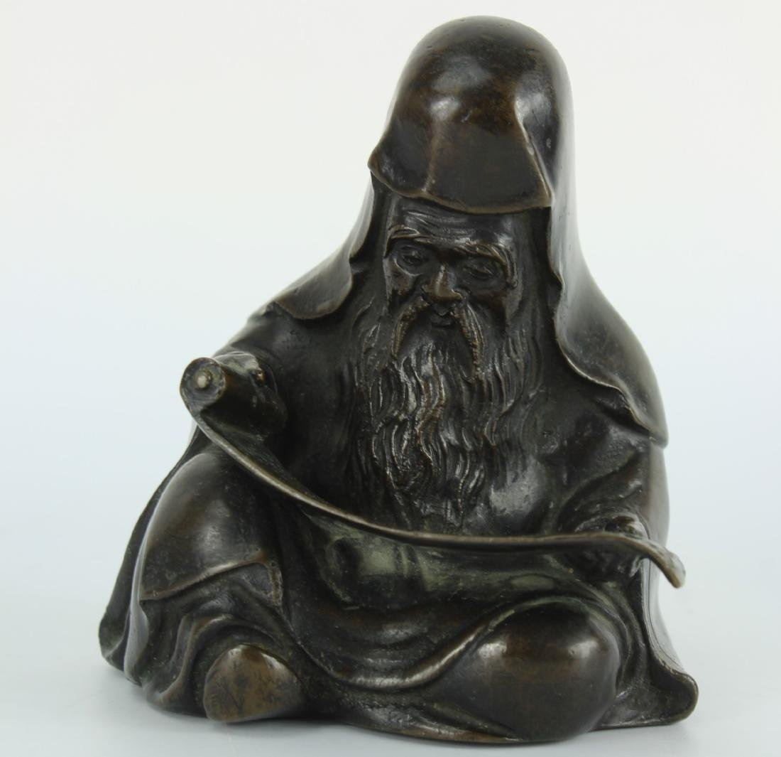 Japanese bronze figure of a Sage wearing robe, seated