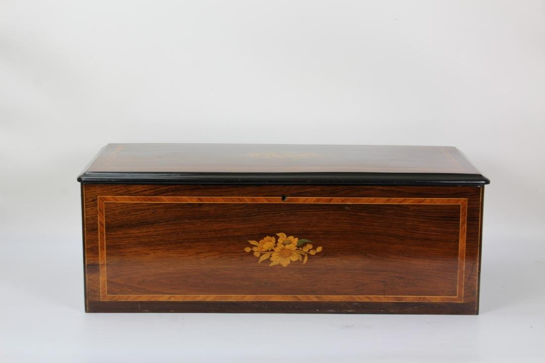 Swiss music box with inlays and a list of 10 songs