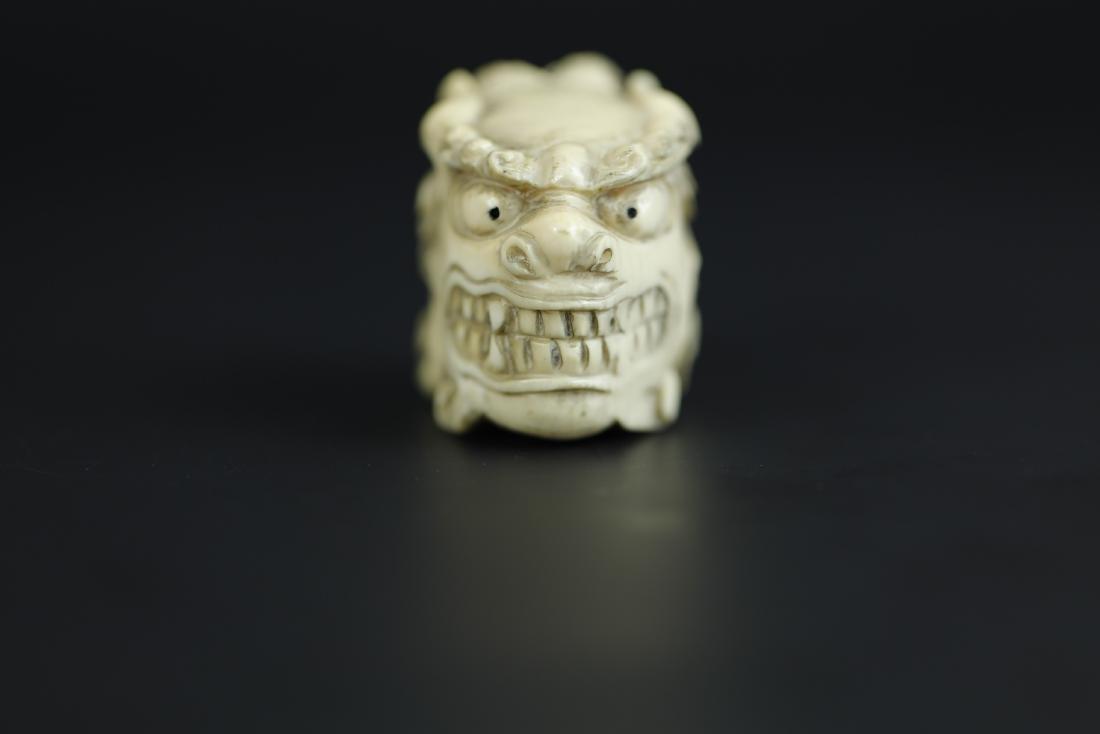 Japanese Netsuke carving of a foo lion's head
