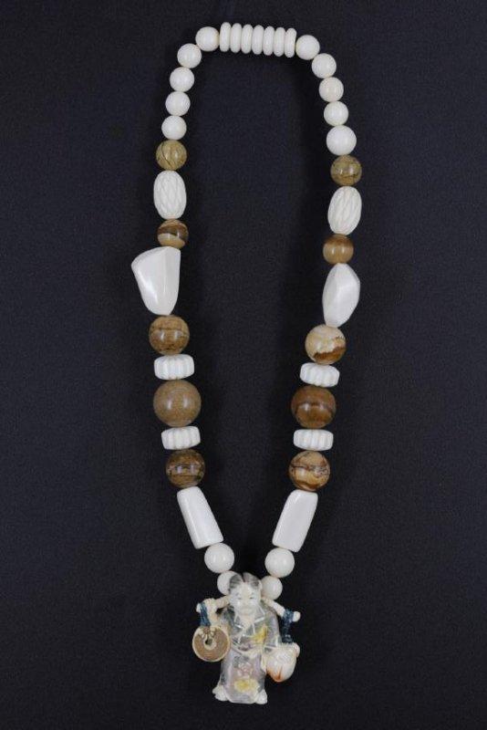 A Japanese Colorized Netsuke on Necklace