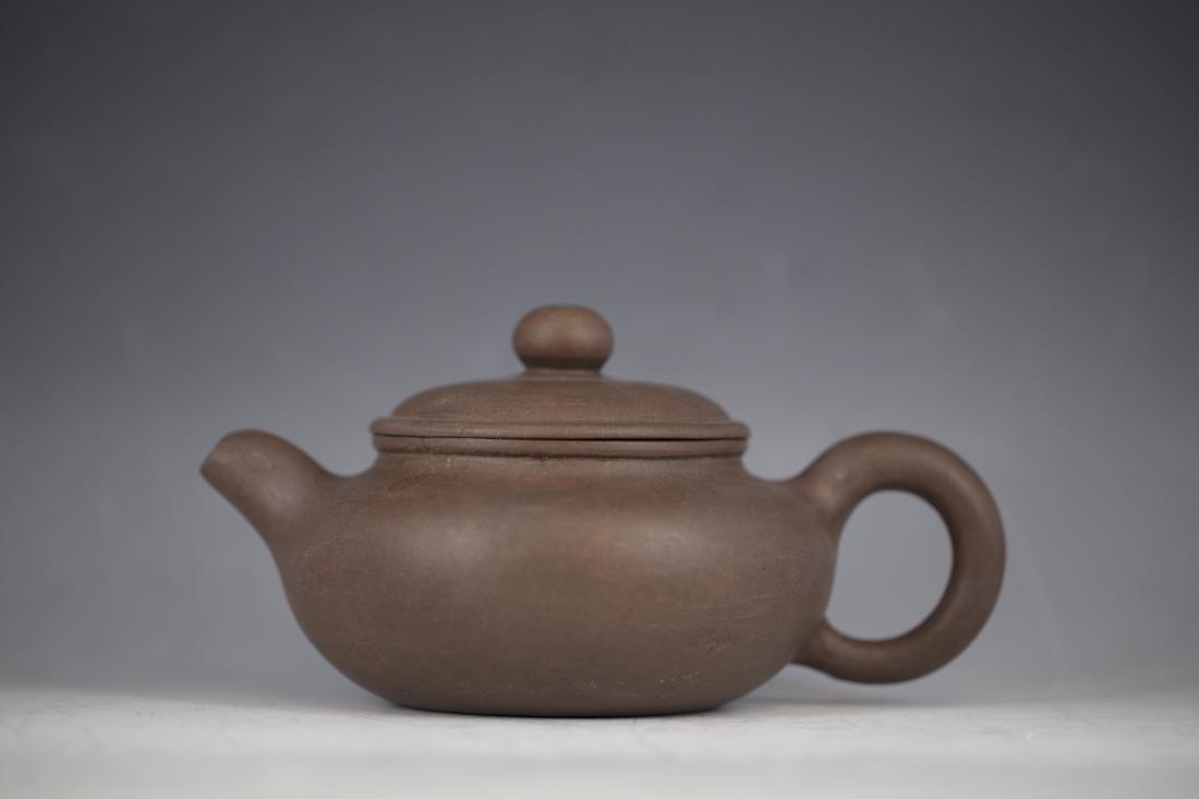 A Chinese Zisha Teapot by Gu Jing Zhou