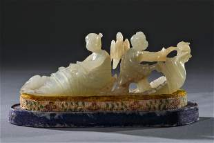 A Carved Hetian Jade Figure