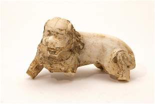 A Carved White Jade Lion