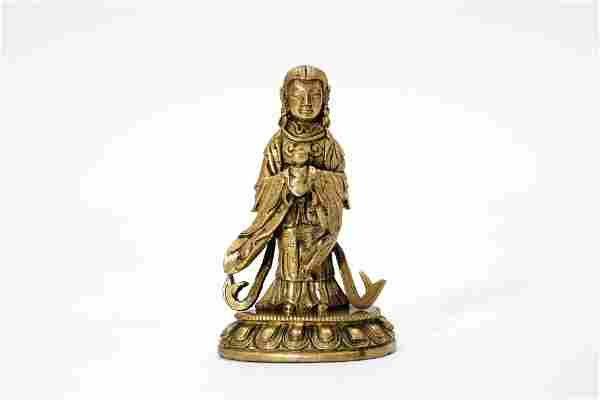 A Gilt Bronze Xiwangmu Queen Mother of the West Figure