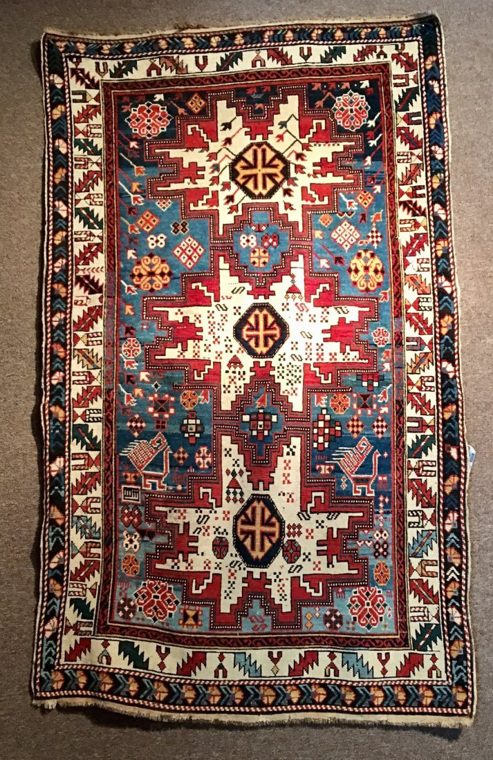 "ANTIQUE LESKE STAR KAZAK MEASURES 3'6"" X 6'"