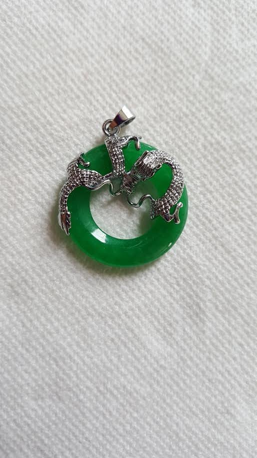 An Exquisite Dragon Jade Pendant.