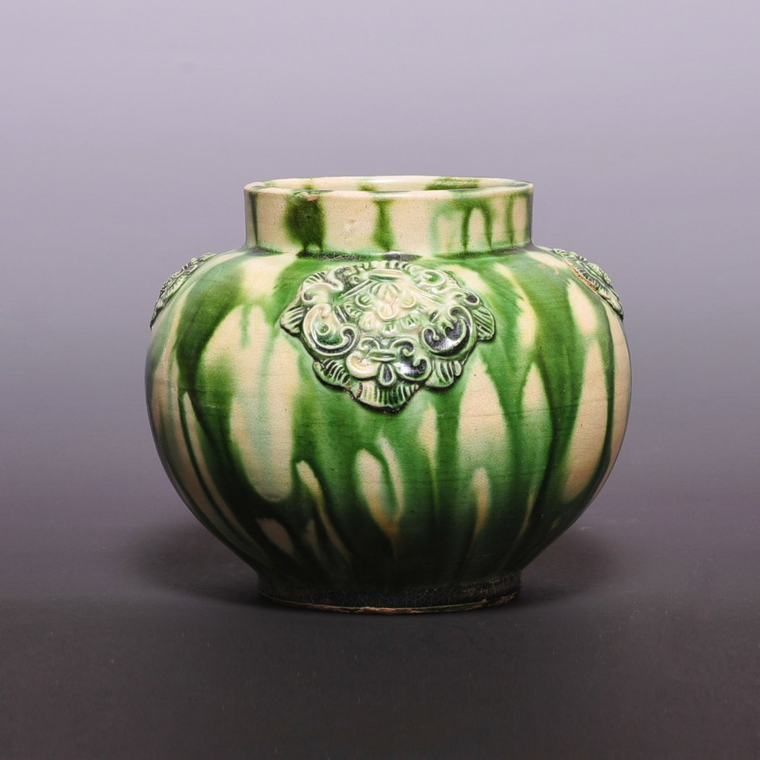 Tang Dynasty, A celadon glazed relief-deco jar