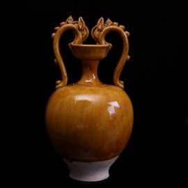 TANG DYNASTY, A YELLOW GLAZE 'DRAGON' PORCELAIN POT