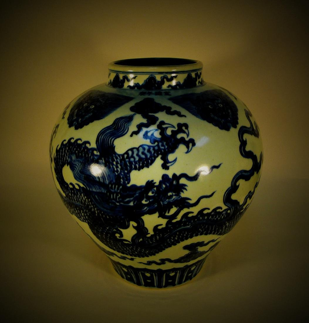 Early Ming Dynasty blue and white carved dragon big pot