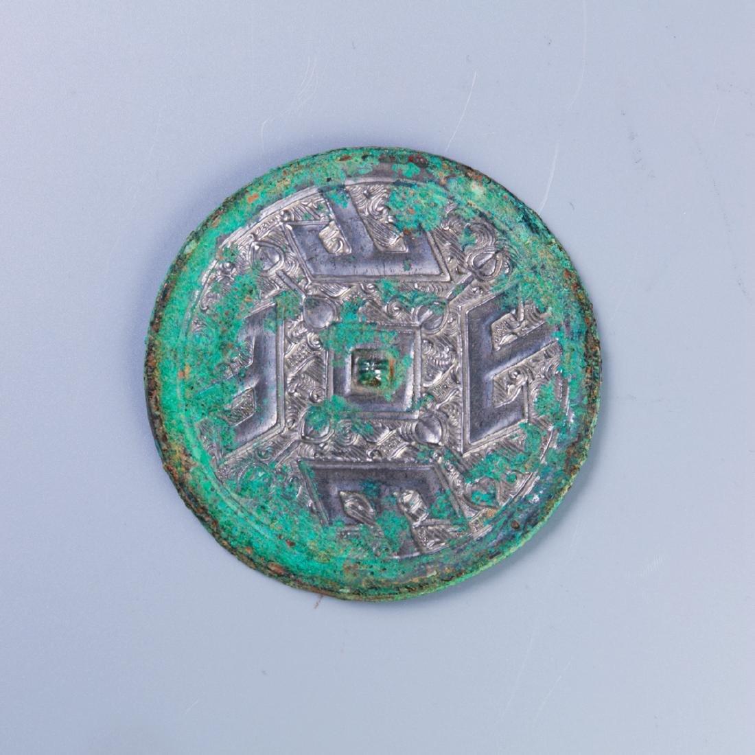 A Chinese Bronze Mirror