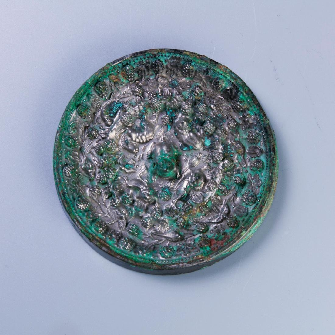 A Chinese Bronze Mirror