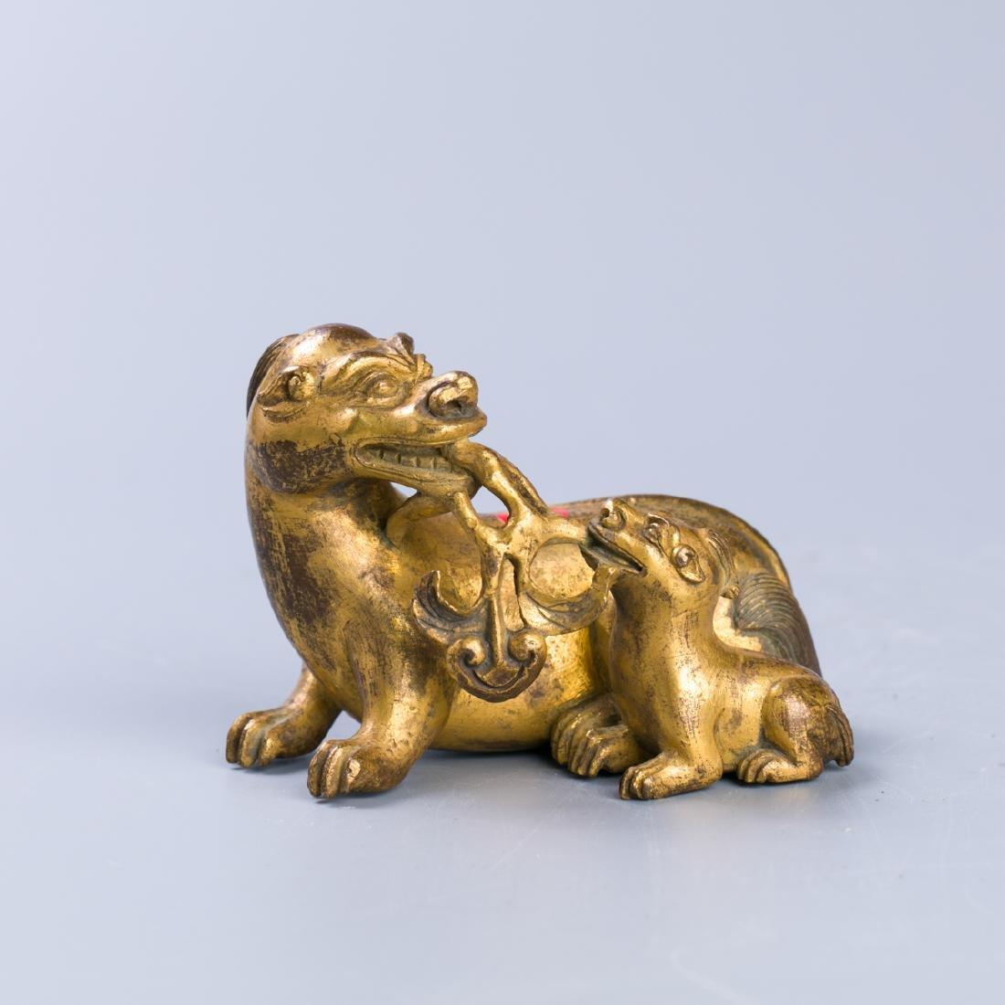 A Chinese Gilt Bronze beast