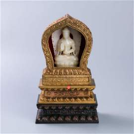 WHITE JADE BUDDHA ON GILT BRONZE AURA THRONE