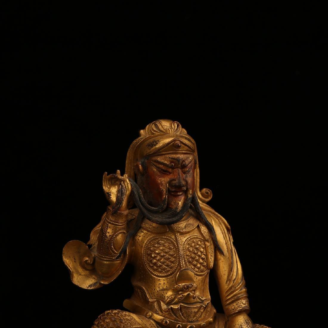 A CHINESE GILT BRONZE FIGURE OF BUDDHA - 4