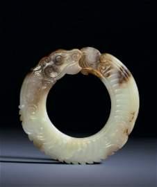 A RARE WHITE JADE RING