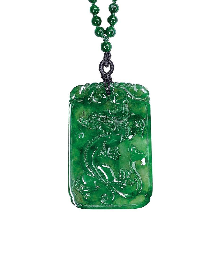 An Icy Jadeite 'Dragon and Phoenix' Pendant and Jadeite