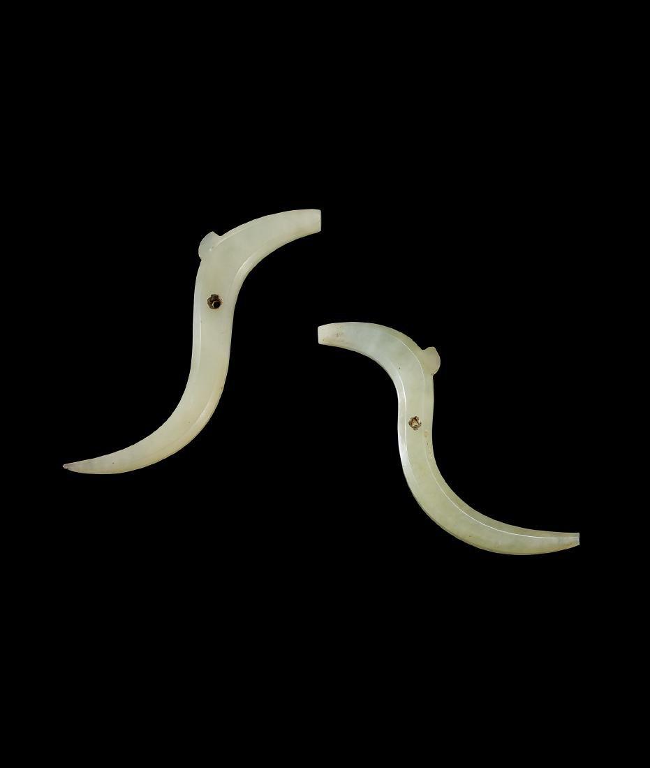 A Pair of White Jade 'Dragon' Pendants, Xi