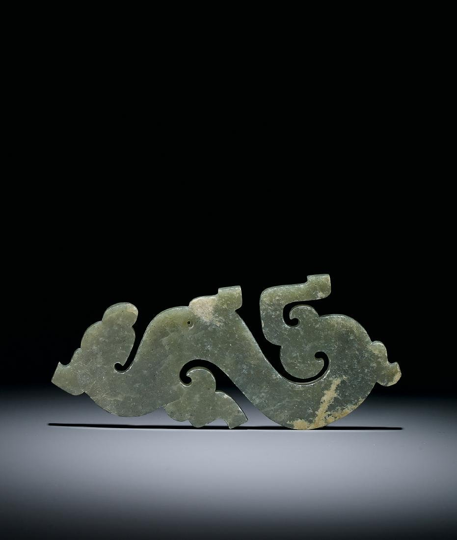 A Celadon Jade 'Dragon and Phoenix' Pendant