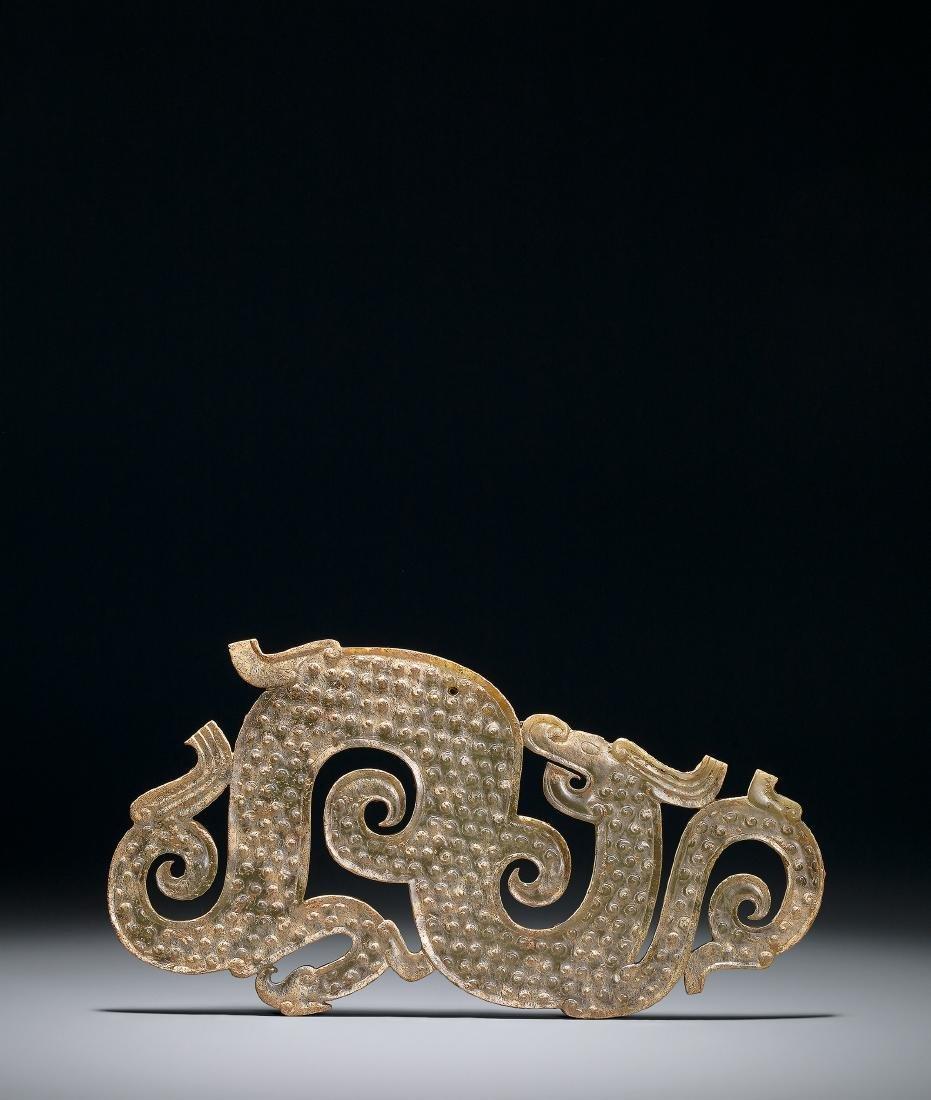 A Celadon Jade 'Dragon' Pendant Warring States