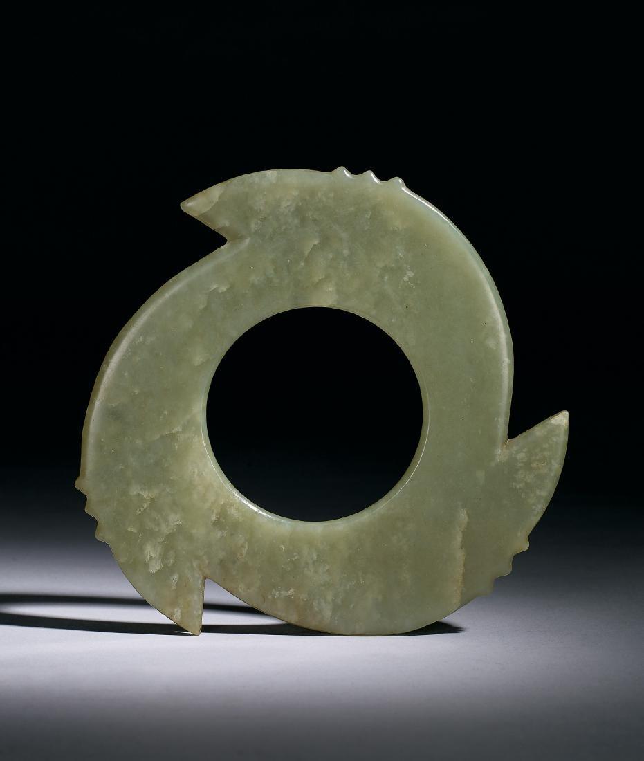 A Celadon Jade Notched Disc, Xuanji Late Shang