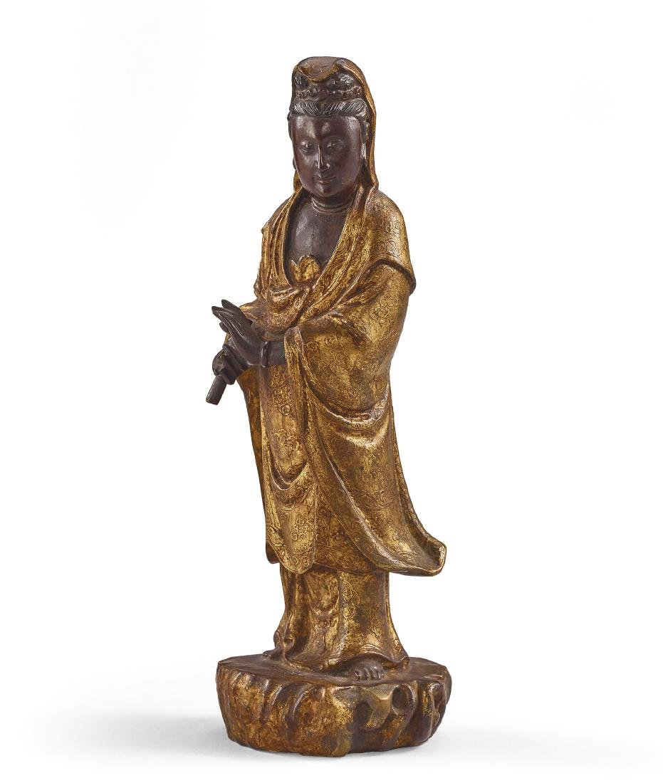 A Gold-Lacquered Wood Figure of Guanyin Qing