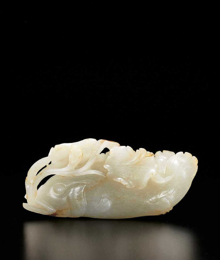 A Finely Carved White Jade Carving of a Fish