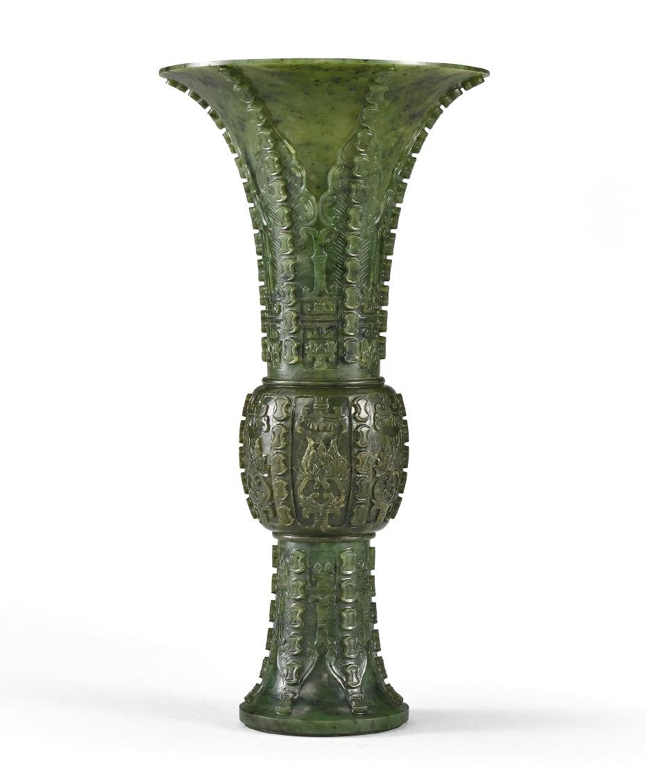 A Spinach-Green Jade Beaker 'Lotus' Vase Qing