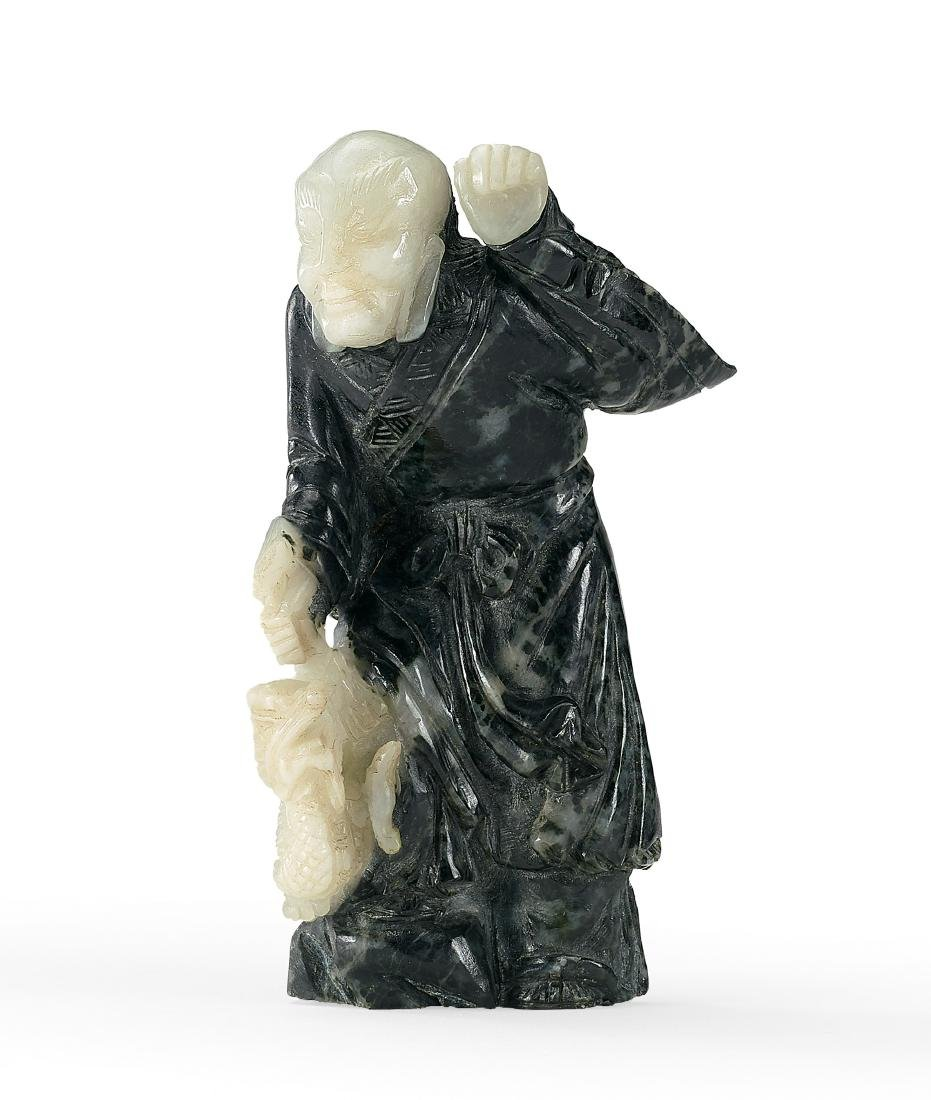 A Carved Black and White Jade Luohan Qing