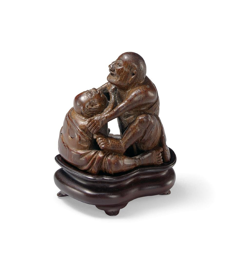 A Finely Carved Bamboo Figure of Fighting