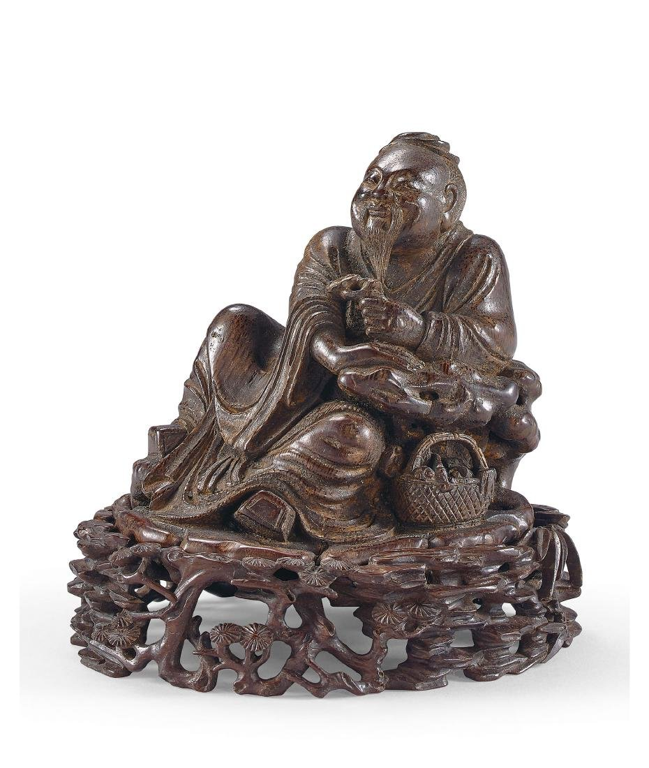 A Finely Carved Bamboo Figure of A Seated