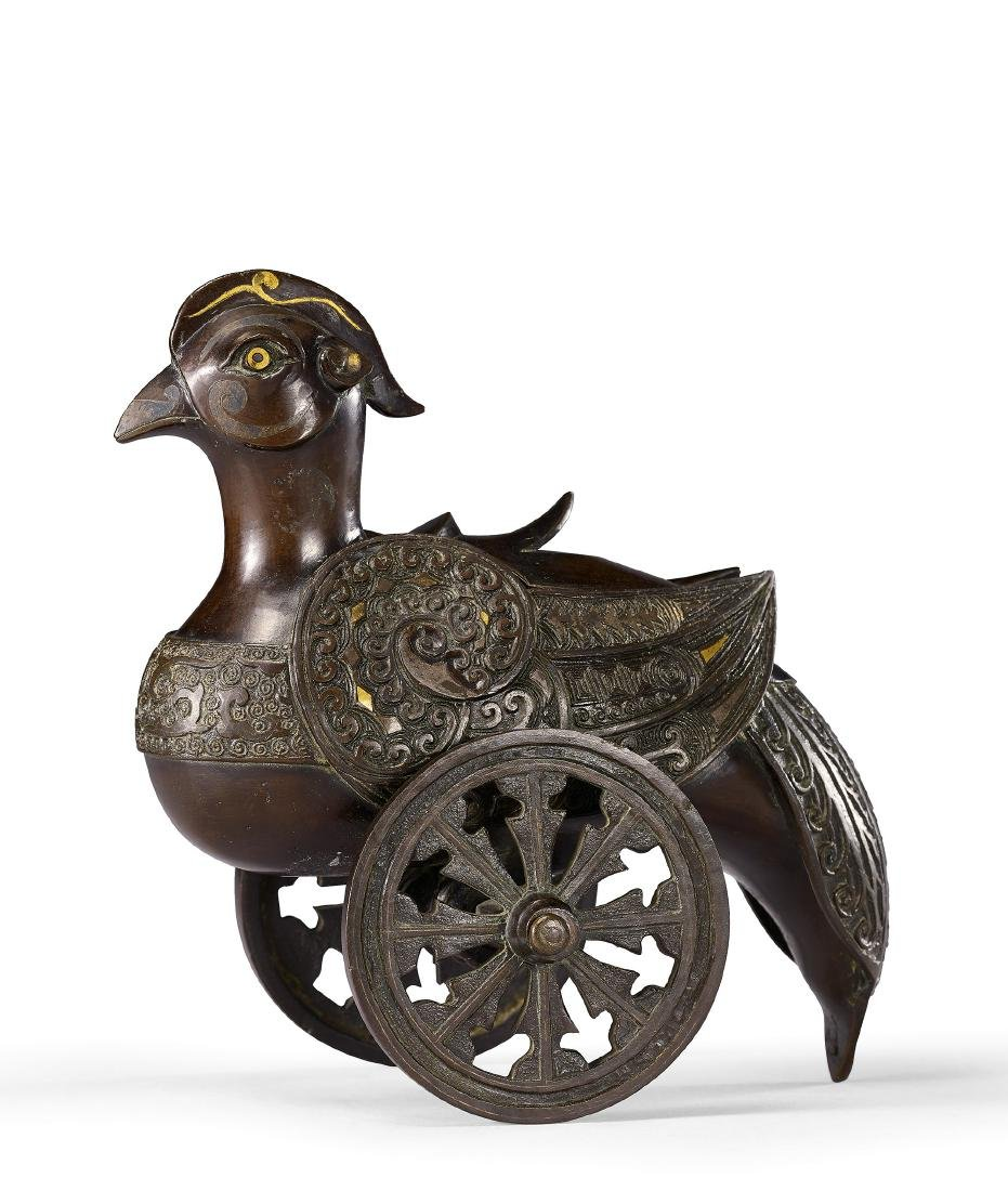 A Fine Archaistic Inlaid and Damascened Bronze Bird