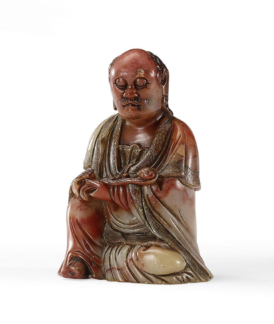 A Finely Carved Soapstone Figure of Luohan holding a
