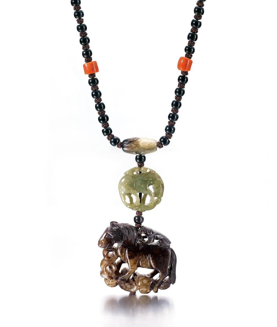 Dream of a Stranger A JADE 'HORSE AND MONKEY' PENDANT