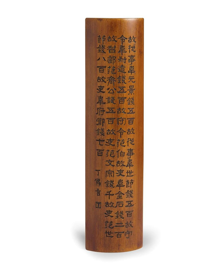 A CARVED AND INSCRIBED BAMBOO WRISTREST SIGNED DING