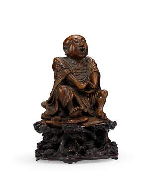 A Finely Carved Bamboo Root Figure of Luohan, 18c.
