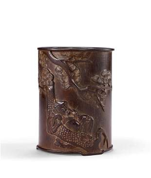 A Carved Zitan 'Pine' Brushpot, Qing Dynasty