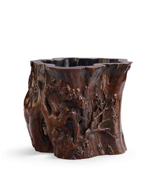 A Carved Wood 'Prunus' Brushpot, Qing Dynasty