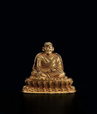 A Gilt-Bronze Figure of Guru, 16c.