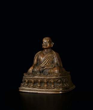 A Silver-Inlaid Bronze Figure of Tsongkhapa, 15c.