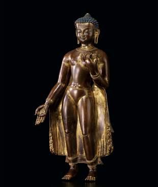 A Rare and Large Gilt Bronze Figure of Sakyamuni,