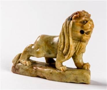 A SOAPSTONE FIGURE OF A LION 20th c 65 cm